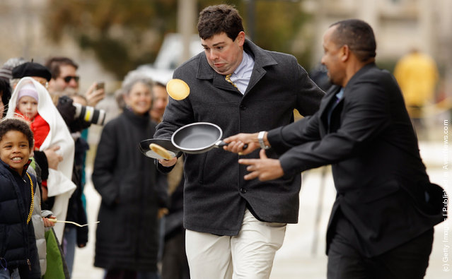 A competitor looses control of his pancake while racing during the Shrove Tuesday, or Mardi Gras, tradition at the National Cathedral