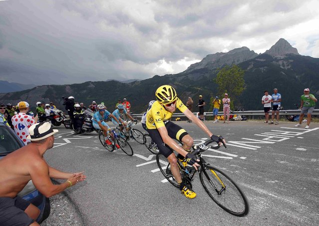 Team Sky rider Chris Froome of Britain (R), race leader's yellow jersey, cycles followed by Astana rider Vincenzo Nibali of Italy during the 161-km (100 miles) 17th stage of the 102nd Tour de France cycling race from Digne-les-Bains to Pra Loup in the French Alps mountains, France, July 22, 2015. (Photo by Eric Gaillard/Reuters)