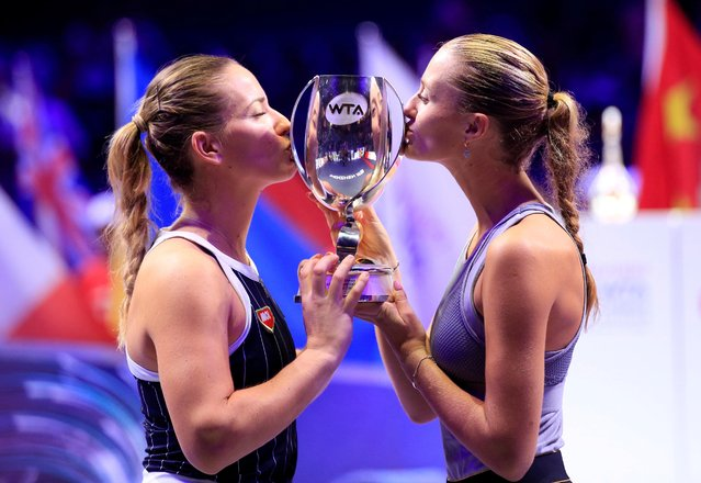 Timea Babos (L) of Hungary/Kristina Mladenovic of France kiss the trophy after the doubles final against Hsieh Su-wei of Chinese Taipei/Barbora Strycova of the Czech Republic at the WTA Finals Tennis Tournament in Shenzhen, south China's Guangdong Province, November 3, 2019. (Photo by Aly Song/Reuters)