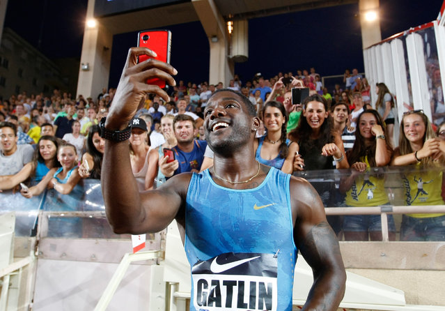 US Justin Gatlin takes selfie after winning the 100m men race at the Herculis International Athletics Meeting, at the Louis II Stadium in Monaco, Friday, July 17, 2015. (Photo by Claude Paris/AP Photo)