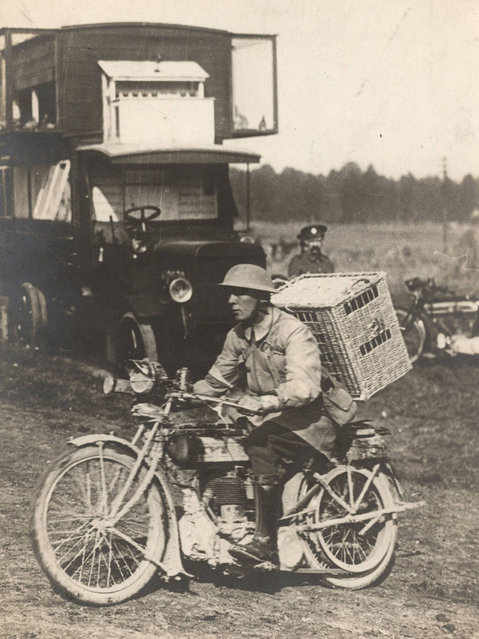 A British soldier rides a motorbike with a basket of pigeons on his back, on his way to delivering them to the frontline on the Western Front in this c1916 handout picture. This picture is part of a previously unpublished set of World War One (WWI) images from a private collection. The pictures offer an unusual view of varied and contrasting aspects of the conflict, from high tech artillery to mobile pigeon lofts, and from officers partying in their headquarters to the grim reality of life and death in the trenches. The year 2014 marks the centenary of the start of the war. (Photo by Reuters/Archive of Modern Conflict London)