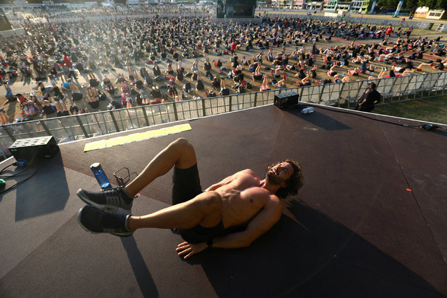 British fitness personality Joe Wicks leads an attempt to break the Guinness World Record for largest High Intensity Interval Workout in Hyde Park in London, Britain July 5, 2017. (Photo by Neil Hall/Reuters)