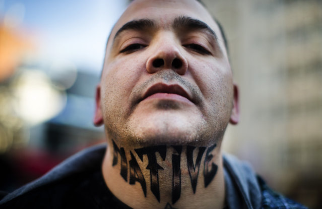 "First Nations protester Leo Marcel Neveu poses to show his tattoo which reads ""Native"" on his neck as he takes part in the ""Idle No More"" demonstration in Toronto, January 16, 2013. (Photo by Mark Blinch/Reuters)"