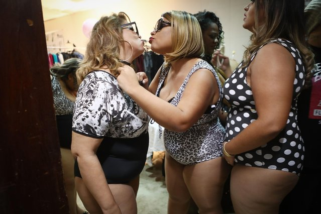 Contestants air kiss whike preparing to compete during the Miss Plus Size Carioca beauty pageant on July 8, 2017 in Rio de Janeiro, Brazil. (Photo by Mario Tama/Getty Images)