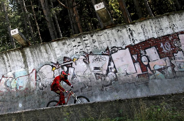 Downhill biker Kemal Mulic trains on the disused bobsled track from the 1984 Sarajevo Winter Olympics on Trebevic mountain near Sarajevo, Bosnia and Herzegovina, August 8, 2015. (Photo by Dado Ruvic/Reuters)