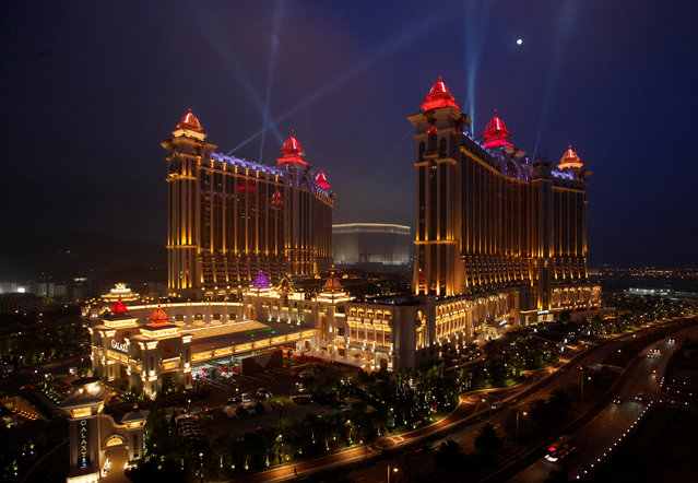 Galaxy Macau, the latest resort in Macau built by Galaxy Entertainment Group, is lit up in the evening after it opened for business May 15, 2011. (Photo by Bobby Yip/Reuters)