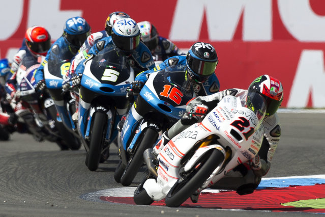 Moto3 rider Francesco Bagnaia of Italy (21) leads Andrea Migno of Italy (16) and the pack during the Moto3 race of the Dutch Grand Prix in Assen, Northern Netherlands, Sunday, June 26, 2016. (Photo by Vincent Jannink/AP Photo)