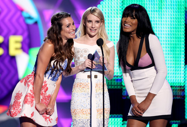 Lea Michele, from left, Emma Roberts and Keke Palmer present the award for choice movie at the Teen Choice Awards at the Galen Center on Sunday, August 16, 2015, in Los Angeles. (Photo by Matt Sayles/Invision/AP Photo)