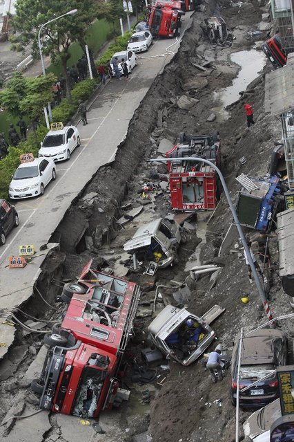 Vehicles are left lie in a destroyed street following multiple explosions from an underground gas leak in Kaohsiung, Taiwan, early Friday, August 1, 2014. (Photo by AP Photo)