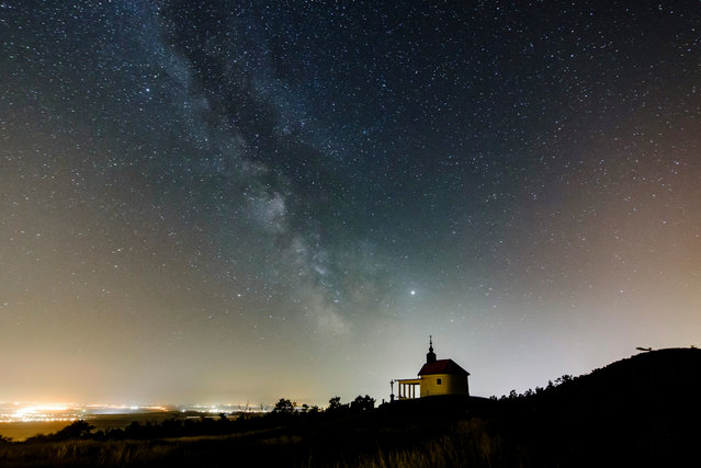 The Milky Way is visible in the clear night sky above the Saint Anne Chapel near Abasar, Hungary, late 30 June 2019. (Photo by Péter Komka/EPA/EFE)