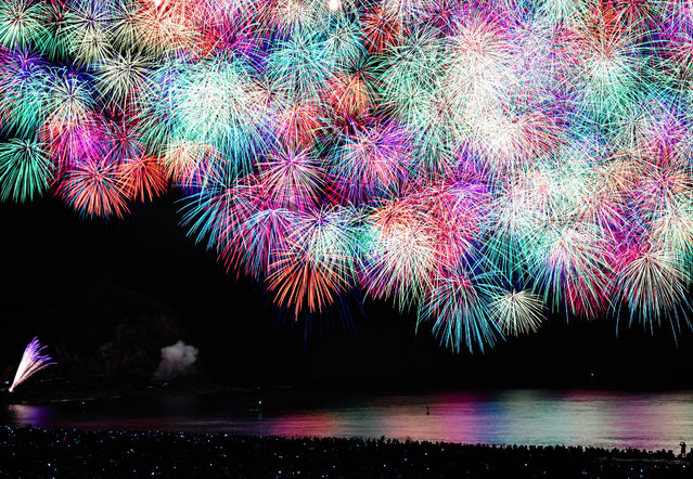 Fireworks explode during the Kumano Fireworks Festival at Shichirimihama Beach on August 17, 2017 in Kumano, Mie, Japan. (Photo by The Asahi Shimbun via Getty Images)