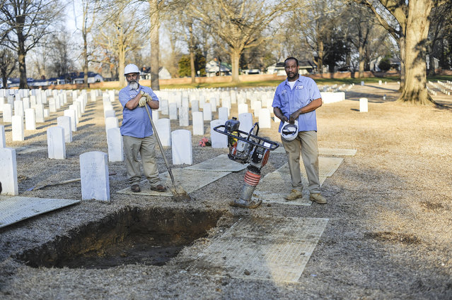 Ricketts was buried near his hometown at the Corinth National Cemetery. After his coffin was lowered in the ground, a small crew shoveled dirt over the grave, pounding it with a mechanical dirt-packer. (Photo and caption by Van Agtmael/Harrison Jacobs/Magnum Photos)