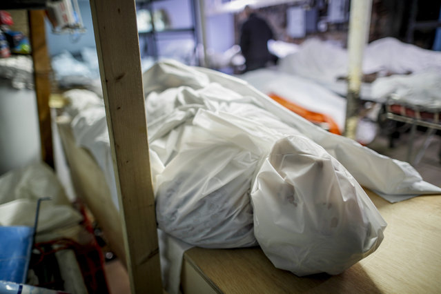 Bodies are wrapped in protective plastic in a holding facility at Daniel J. Schaefer Funeral Home, Thursday, April 2, 2020, in the Brooklyn borough of New York. The company is equipped to handle 40-60 cases at a time. But amid the coronavirus pandemic, it was taking care of 185 Thursday morning. (Photo by John Minchillo/AP Photo)