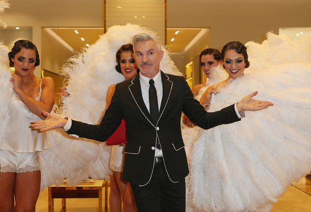 Baz Luhrmann poses with models inside of a store as he attends the launch of Emporium Melbourne on August 20, 2014 in Melbourne, Australia. (Photo by Scott Barbour/Getty Images)