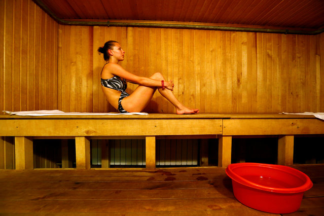 Belarussian rhythmic gymnast Melitina Staniouta sits in a sauna at a sports base as she prepares for the 2016 Rio Olympics in Minsk, June 9, 2016. (Photo by Vasily Fedosenko/Reuters)