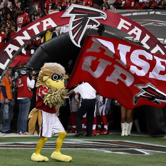 "The Atlanta Falcons mascot holds a ""Rise Up"" flag prior to the NFC Championship game against the San Francisco 49ers at the Georgia Dome, 2013-1-20. (Photo by Matthew Emmons/USA TODAY Sports)"
