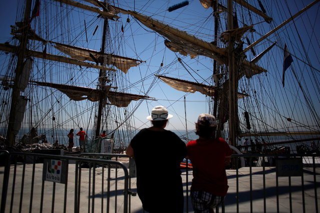People look on during the Tall Ships Races 2016 parade, in Lisbon, Portugal July 25, 2016. (Photo by Pedro Nunes/Reuters)