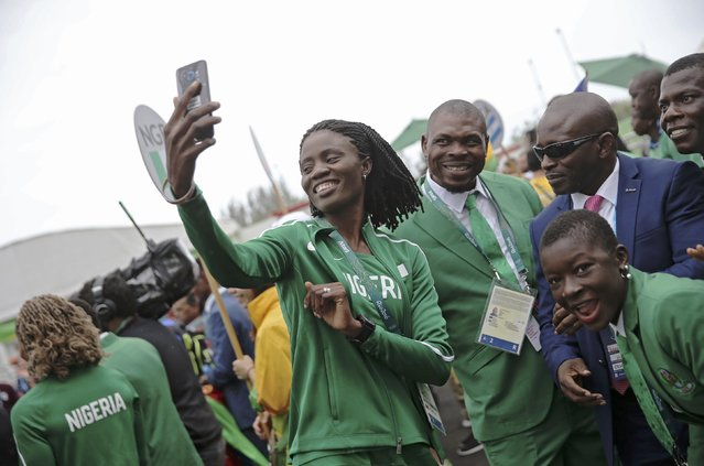 Nigerian team pose for pictures as they arrive at the Olympic Village in Rio de Janeiro, Brazil on August 3, 2016. (Photo by Alkis Konstantinidis/Reuters)