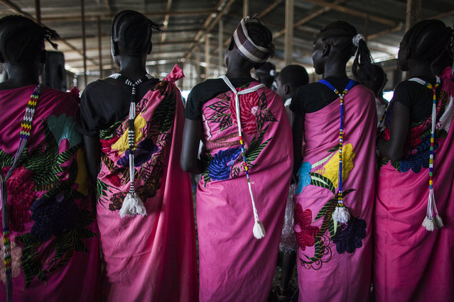 Church members pray at the Dolieb Hill Presbyterian Church in the Protection of Civilians (POC) site at the United Nations Mission in South Sudan (UNMISS) compound in Malakal, South Sudan on Saturday, July 9, 2016. (Photo by Jane Hahn/The Washington Post)