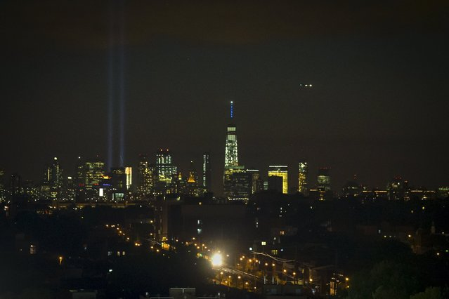 The Tribute in Light illuminates the Lower Manhattan sky as the 7 Subway train rumbles toward the Billie Jean King Tennis Center on the 14th anniversary of the 9/11 attacks in New York September 11, 2015. (Photo by Carlo Allegri/Reuters)