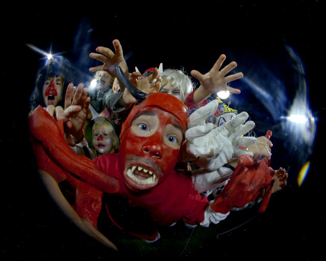 Kids in Halloween costumes are seen through a fisheye lens, October 31, 1966. Location is unknown. (Photo by AP Photo)