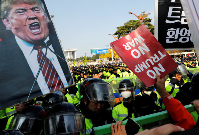 Anti-Trump protesters hold up signs in front of police officers near the South Korean National Assembly where U.S. President Donald Trump made a speech, in Seoul, South Korea, November 8, 2017. (Photo by Kim Kyung-Hoon/Reuters)