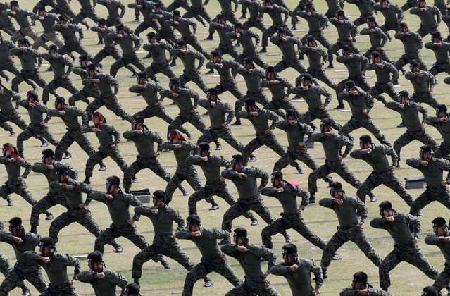 South Korean army soldiers demonstrate their martial arts skills during the 66th anniversary of Armed Forces Day at the Gyeryong military headquarters in Gyeryong, South Korea, Wednesday, October 1, 2014. (Photo by Ahn Young-joon/AP Photo)