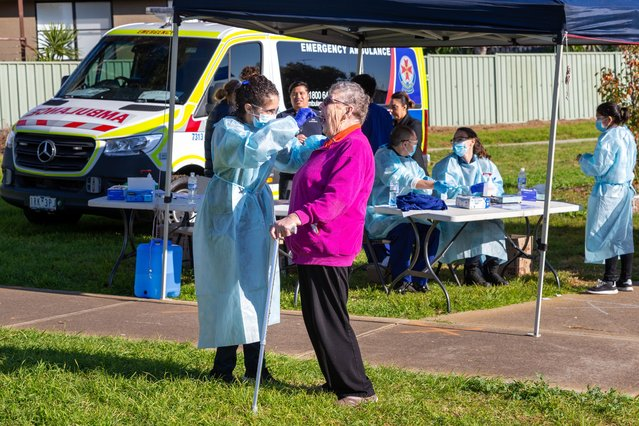 An elderly woman is tested at a pop-up clinic during a COVID-19 testing blitz in the suburb of Broadmeadows on June 28, 2020 in Melbourne, Australia. Victoria's confirmed COVID-19 infection numbers continue to rise, with 49 new coronavirus cases recorded overnight. Health authorities are continuing on a testing blitz in Melbourne suburbs that have been identified as community transmission hotspots for coronavirus. Restrictions in Victoria have been tightened in response to the spike in new cases across the state with premier Daniel Andrews extending the current state of emergency for at least four weeks to allow police the power to enforce social distancing rules. (Photo by Asanka Ratnayake/Getty Images)
