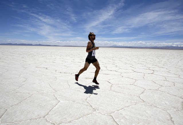 A participant runs across the salt flat as he takes part in the K42 race in Uyuni, south of La Paz, Bolivia, October 4, 2014. (Photo by David Mercado/Reuters)