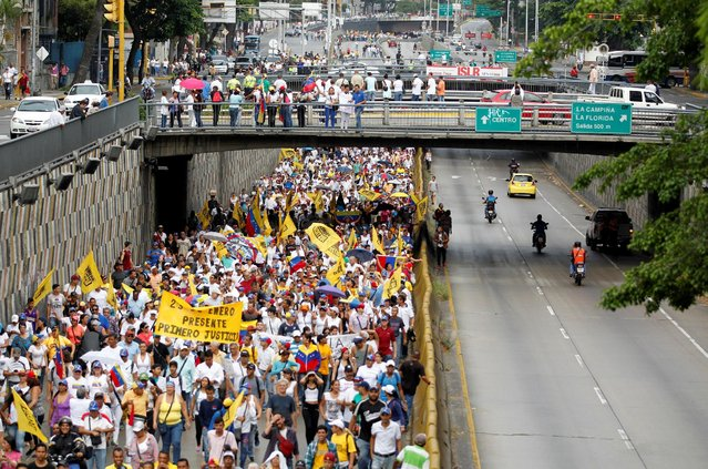 Opposition supporters take part in a rally to demand a referendum to remove Venezuela's President Nicolas Maduro in Caracas, Venezuela, September 1, 2016. (Photo by Christian Veron/Reuters)