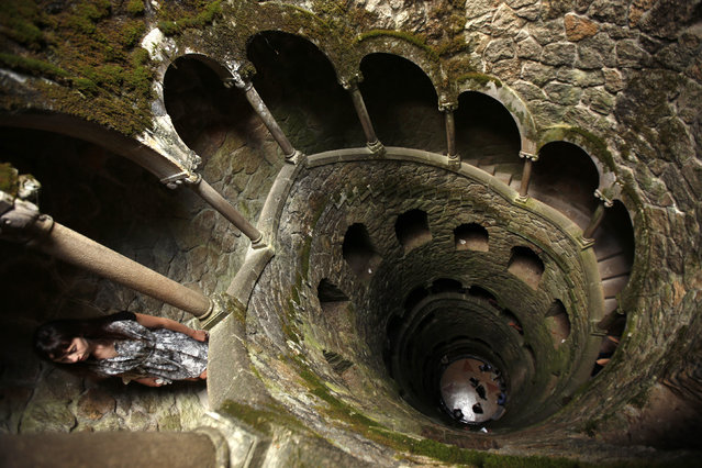 A visitor walks inside the initiation well at Quinta da Regaleira in Sintra October 6, 2014. (Photo by Rafael Marchante/Reuters)