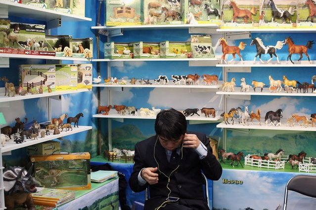 A man sits on a trade stand during the 2013 London Toy Fair at Olympia Exhibition Centre on January 22, 2013 in London, England. The annual fair which is organised by the British Toy and Hobby Association, brings together toy manufacturers and retailers from around the world.  (Photo by Dan Kitwood)