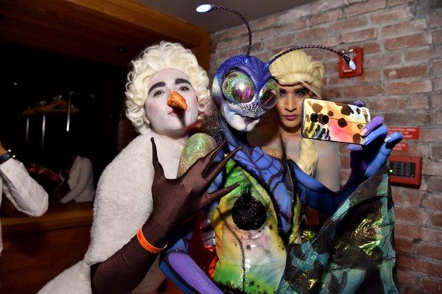 Jesus Estrada, Heidi Klum and Antonio Estrada attend Moto X presents Heidi Klum's 15th Annual Halloween Party sponsored by SVEDKA Vodka at TAO Downtown on October 31, 2014 in New York City. (Photo by Mike Coppola/Getty Images for Heidi Klum)