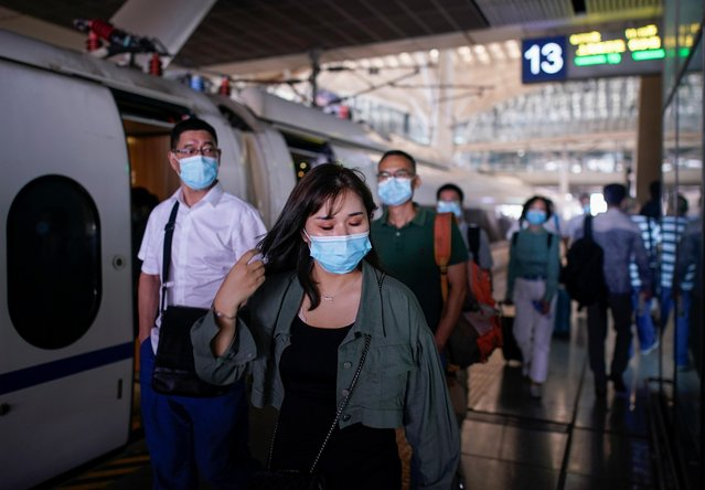 People wearing face masks arrive at Wuhan Railway Station, following the coronavirus disease (COVID-19) outbreak in Wuhan, Hubei province, China on September 2, 2020. (Photo by Aly Song/Reuters)