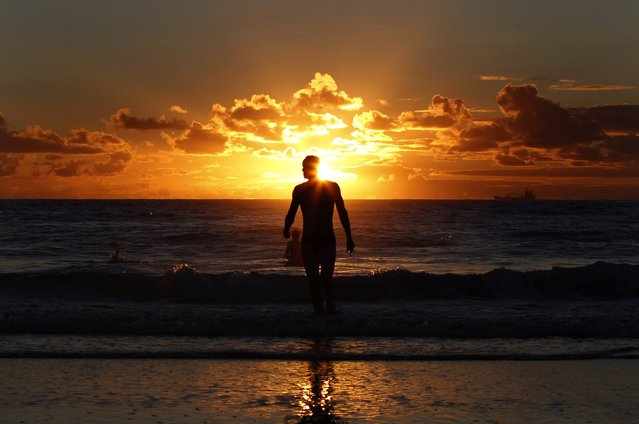 A man leaves the water after swimming at Sydney's Coogee beach at sunrise February 14, 2013. (Photo by Daniel Munoz/Reuters)