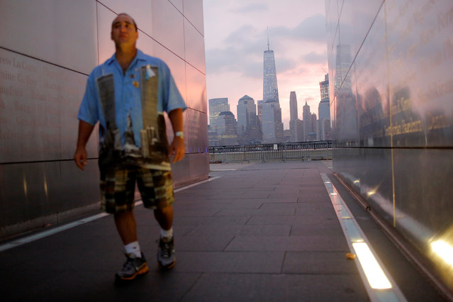 Steven Monetti Jr. walks through the Empty Sky memorial on the morning of the 15th anniversary of the 9/11 attacks in New Jersey, U.S., September 11, 2016. (Photo by Andrew Kelly/Reuters)