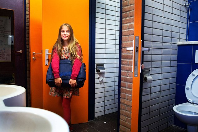 "Belgium. Rosalie, 9, goes to school in Brussels. ""At my school we have separate toilets for girls and boys on every floor. My classroom is on the 3rd floor. We have 22 toilets, which are shared between 230 pupils and 20 adults. The teachers at school let us go to the toilet whenever we need to"". (Photo by Tim Dirven/WSUP/Panos)"