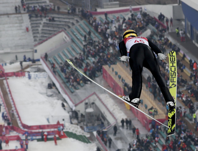 Fabian Riessle, of Germany, soars through the air during the trial jump in the nordic combined competition at the 2018 Winter Olympics in Pyeongchang, South Korea, Wednesday, February 14, 2018. (Photo by Kirsty Wigglesworth/AP Photo)