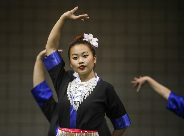 Kristy Yang took the stage to dance with the group: Girls from the East Side during the Minnesota Hmong New Year celebration Saturday, November 29, 2014, at the Saint Paul RiverCentre in St. Paul, MN. (Photo by David Joles/Star Tribune)