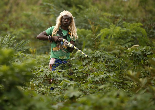 A member of the anti-balaka, a Christian militia, patrols outside the village of Zawa, in this April 8, 2014 file photo. (Photo by Goran Tomasevic/Reuters)