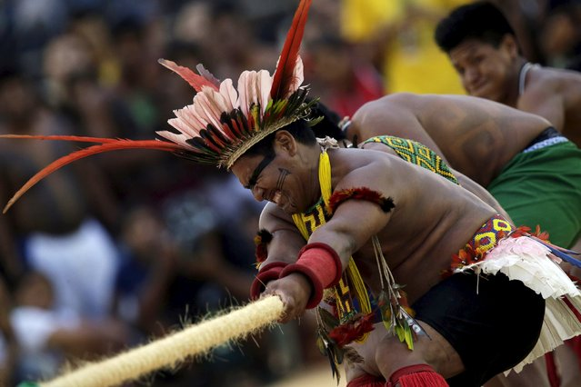 Indigenous people compete during a tug-of-war competition at the first World Games for Indigenous Peoples in Palmas, Brazil, October 25, 2015. (Photo by Ueslei Marcelino/Reuters)