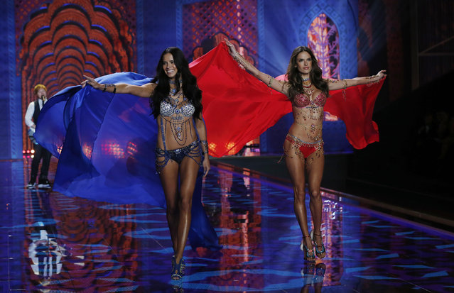 Models Adriana Lima (L) and Alessandra Ambrosio present creations at the 2014 Victoria's Secret Fashion Show in London December 2, 2014. (Photo by Suzanne Plunkett/Reuters)