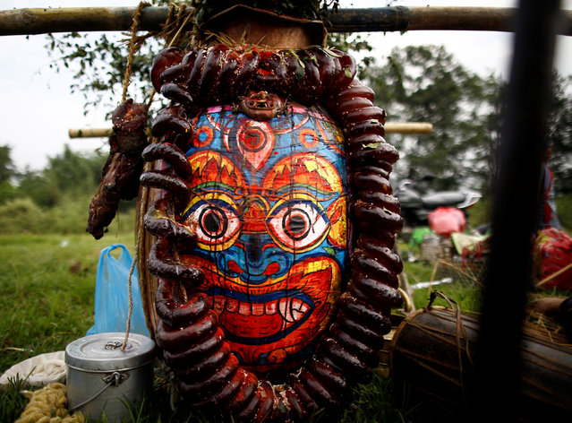 Buffalo intestine offered on the portrait of God Bhairav covered in blood stains is pictured during the Shikali festival at Khokana village in Lalitpur, Nepal October 7, 2016. (Photo by Navesh Chitrakar/Reuters)