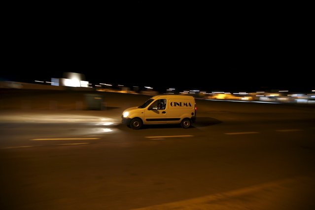 Projectionist Antonio Feliciano, 75, drives home after projecting a film a film in Castro Verde, Portugal September 1, 2013. (Photo by Rafael Marchante/Reuters)