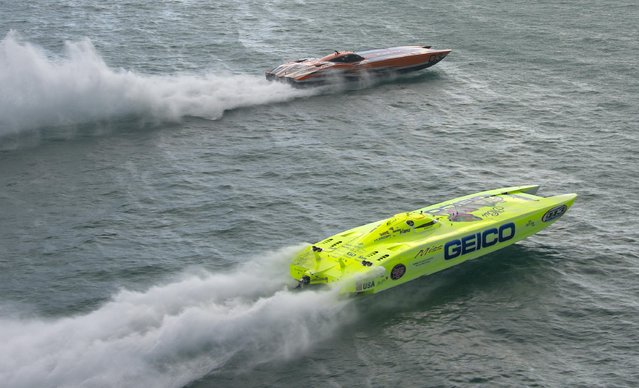 "Marc Granet and Scott Begovich pilot ""Miss Geico"" past the start line in this handout photo provided by the Key West News Bureau during the first of three races at the Key West World Championship, November. 11, 2015, in Key West, Florida. (Photo by Andy Newman/Reuters/Florida Keys News Bureau)"
