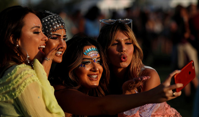 Concertgoers take a selfie at the Coachella Valley Music and Arts Festival in Indio, California, U.S., April 13, 2018. Picture taken April 13, 2018. (Photo by Mario Anzuoni/Reuters)
