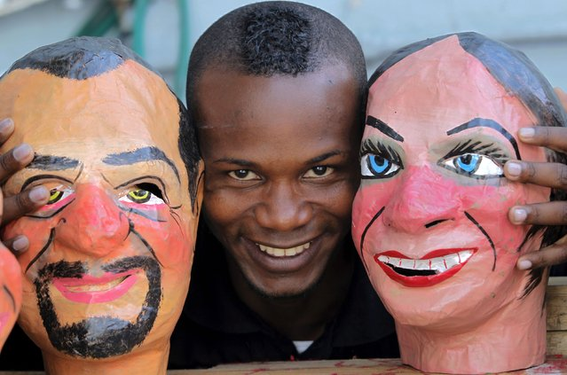 Gabriel Quinonez poses next to handmade masks in Quito December 30, 2014. (Photo by Guillermo Granja/Reuters)