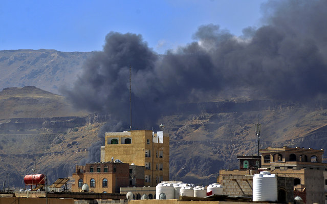 Smoke billows following a reported airstrike by the Saudi-led coalition in the Yemeni capital Sanaa, on November 27, 2020. The Saudi-led military coalition in Yemen bombed rebel camps including in the capital Sanaa, AFP correspondents said, days after the Huthis attacked an oil facility in Saudi Arabia. (Photo by Mohammed Huwais/AFP Photo)