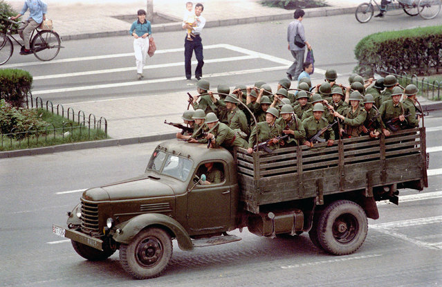 A truck drives Chinese soldiers down Chang'an Boulevard in Beijing, on June 5, 1989, one day after violence between government troops and pro-democracy protesters left hundreds dead. (Photo by Jeff Widener/AP Photo)