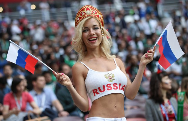 A Russia fan shows her support prior to the 2018 FIFA World Cup Russia Group A match between Russia and Saudi Arabia at Luzhniki Stadium on June 14, 2018 in Moscow, Russia. (Photo by Lars Baron – FIFA/FIFA via Getty Images)